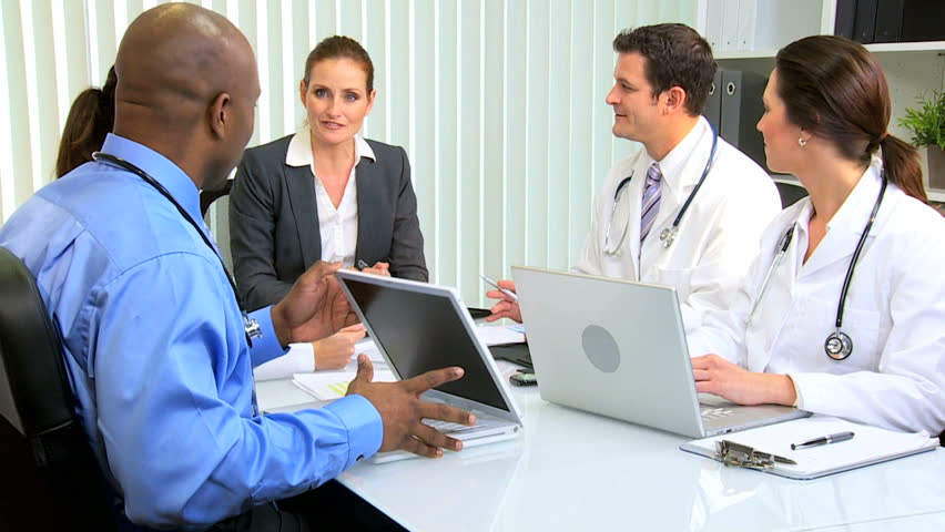 Team multi ethnic medical executives concluding, successful meeting financial consultant | Shutterstock HD Video #2700035