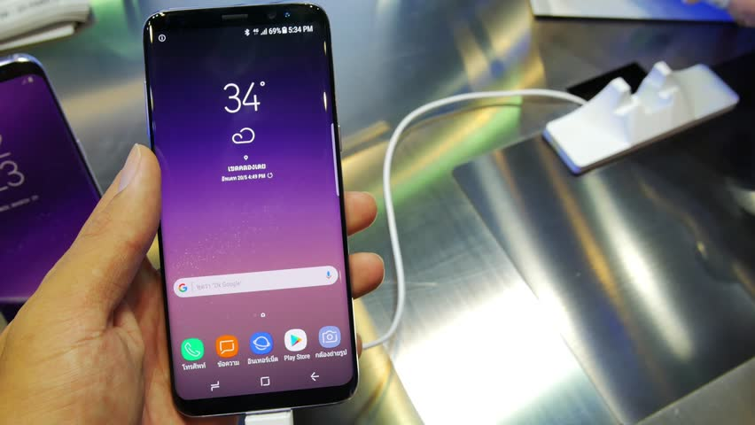 BANGKOK, THAILAND - MAY  20, 2017 :display showing new Samsung Galaxy S8 and people testing it. Samsung S8 are new generation smartphone from Samsung. Samsung S8 is smart phone with multi touch screen