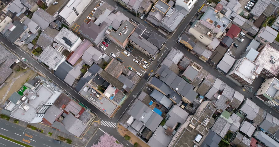 Aerial top view of Kyoto buildings with cherry blossoms trees, Japan