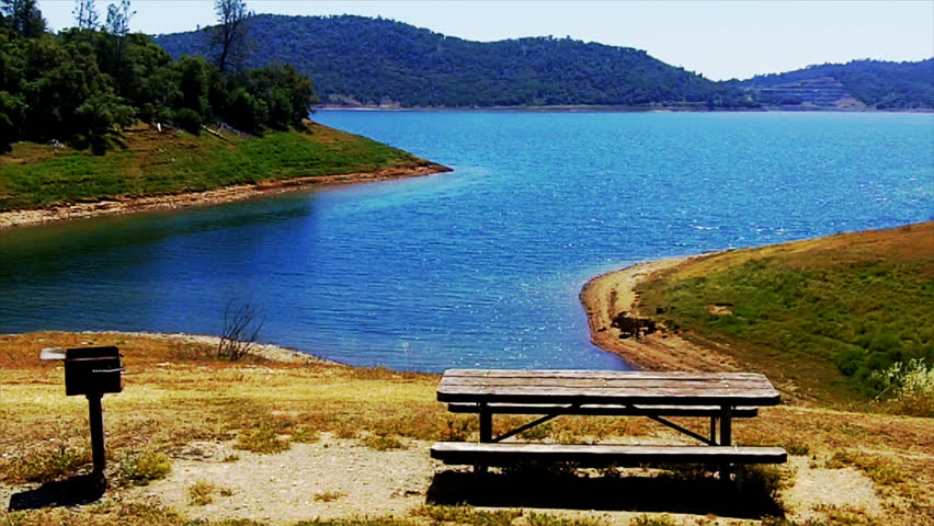 A quiet cove and picnic table on New Melones Lake in Calaveras County near