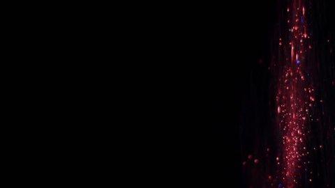 Red glitter, falling down, on black background Fairy magic dust, or unicorn fart :-D