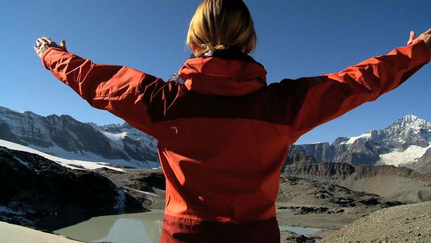 Young woman climbing to the mountain