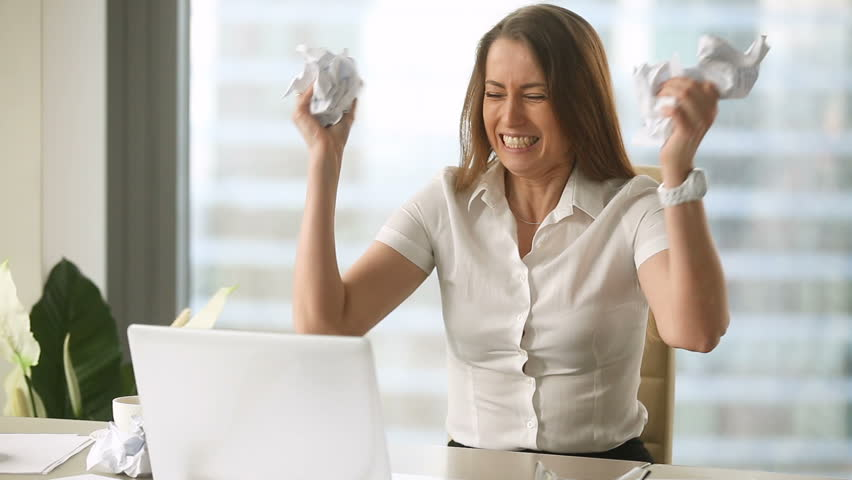 Angry furious female office worker throwing crumpled paper, having nervous breakdown at work, screaming in anger, stress management, mental distress problems, losing temper, reaction on failure  | Shutterstock HD Video #27047875