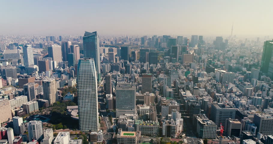 Aerial view of Tokyo skyline with morning light, Japan. Cityscape with downtown buildings. Light effect applied.