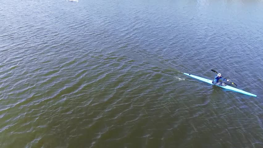 A kayak athlete moves on a water surface. Aerial view | Shutterstock HD Video #27087445