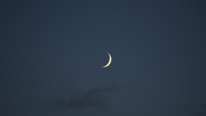 time lapse of crescent moon and clouds