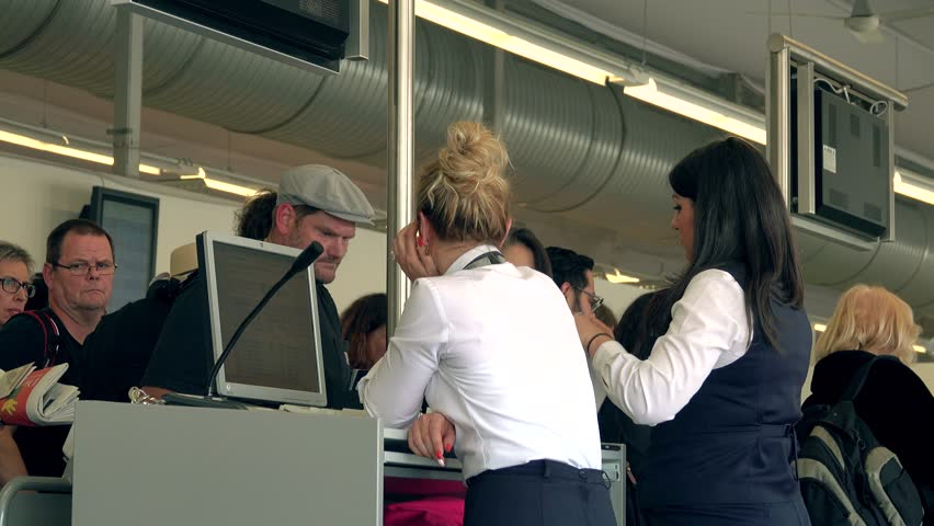 BERLIN, GERMANY - MAY, 18, 2017. Female flight attendants checking passports and boarding cards at airport terminal gate exit. 4K clip | Shutterstock HD Video #27148345