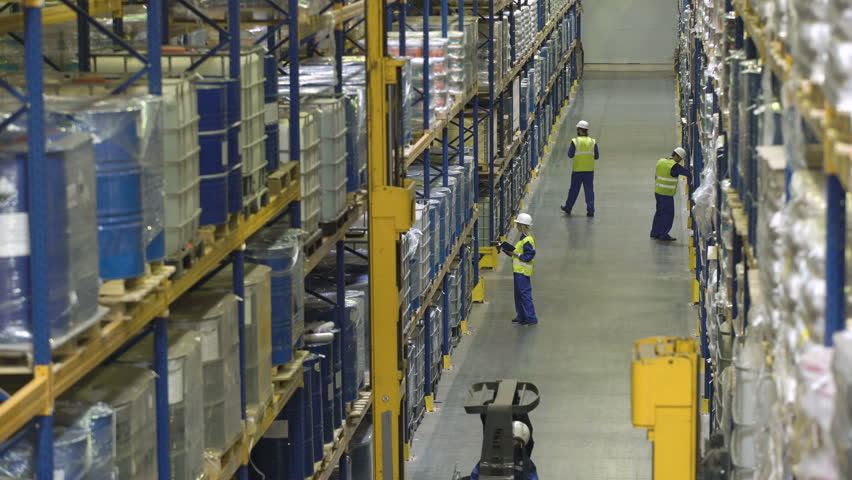 Top view of people and machinery working in modern warehouse | Shutterstock HD Video #27200755