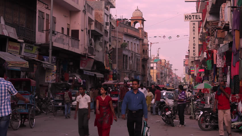 Busy traffic on the street in the neighborhood of Paharganj in New Delhi, India. Timelapse, Fast
