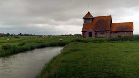 Old Medieval, creepy church. Fairfield church TIMELAPSE in a remote field of sheep in Kent Countryside. Mysterious.