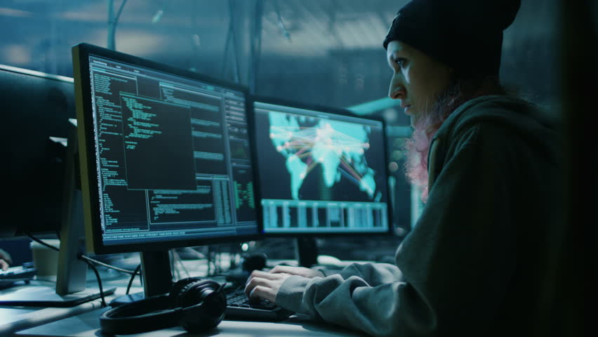 Nonconformist Teenage Hacker Girl Organizes Malware Attack on Global Scale. They're in Underground Secret Location Surrounded by Displays and Cables. Shot on RED EPIC-W 8K Helium Cinema Camera.