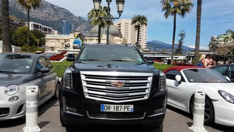 Monte-Carlo, Monaco - May 5, 2017: Luxury Black Cadillac Escalade SUV Parked In Front Of The Casino Of Monte Carlo In Monaco - 4K Video
