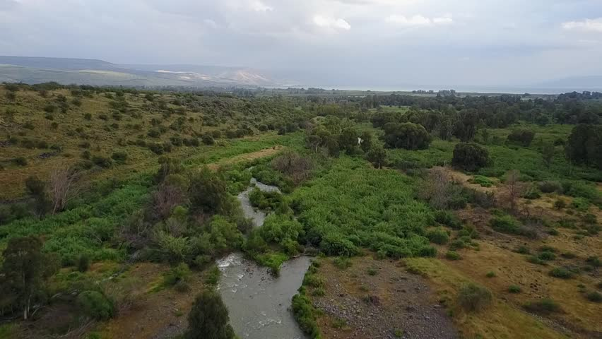 Springtime Aerial above the Jordan River, Flying towards the Sea of Galilee. At the end a Stork Glides into View   Shutterstock HD Video #27366775