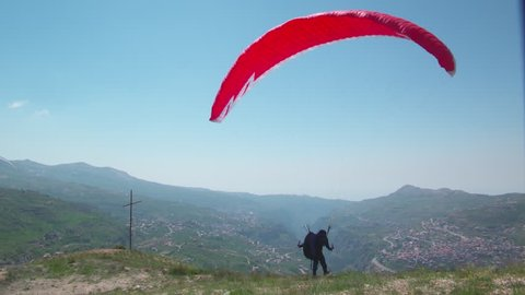 Qadisha Valley, Lebanon. View of a paraglider taking off in the valley, which is home to numerous monasteries and hermitages. UNESCO.