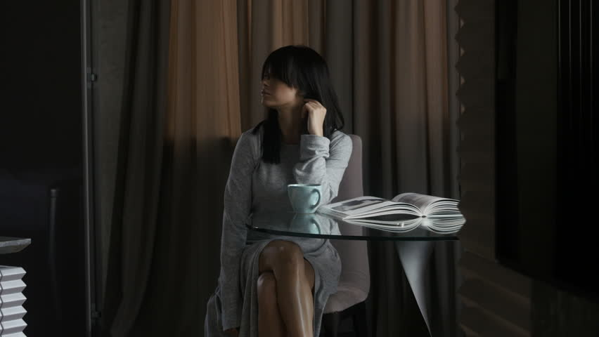 Woman relaxing at table | Shutterstock HD Video #27368425