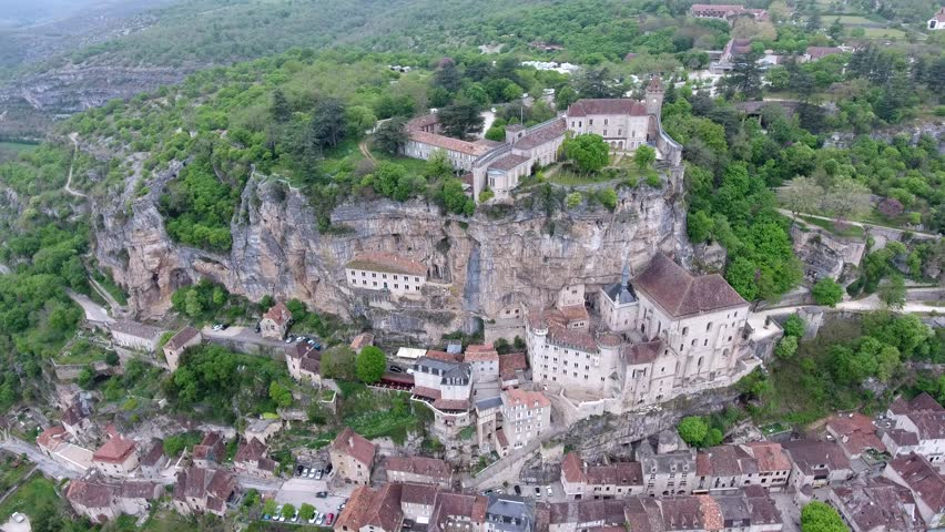 Aerial view. Rocamadour valley: village on hillside, castle on top 3-5 Top interesting point in France: historical monument and sanctuary. The town below the monastic buildings and churches.  | Shutterstock HD Video #27386266