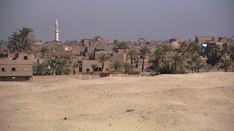 ABYDOS, EGYPT - CIRCA 2002: MCU. Static. The village and desert sands of Abydos village.
