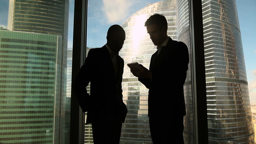 Multicultural two business partners handshaking standing near office full length window and skyscrapers in background, satisfied with successful deal, establishing partnership, effective cooperation | Shutterstock HD Video #27389731