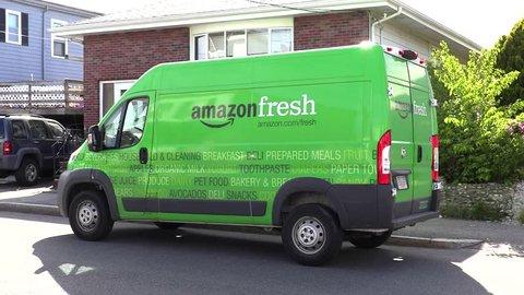 Amazon Fresh truck van, groceries delivery man - Revere, Massachusetts USA - May 27, 2017