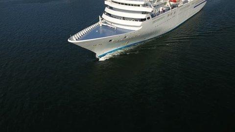 Cruise ship facade details roof ocean. Vladivostok Russia.  Eastern Bosphorus. Summer sunny day. Aerial flight over to the ship 4k