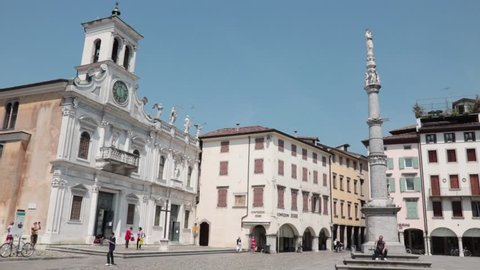 UDINE, ITALY - MAY 30: panning shot of church of san giacomo, view of the chatedral and square, 2017 in Udine