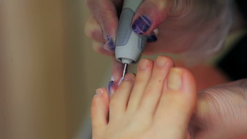 Caring about the girl legs pedicure, polish, beautiful lights. Pedicures in the salon. The master cares for the nails and feet of the client, doing pedicure. Peeling feet pedicure in a beauty salon. | Shutterstock HD Video #27439795