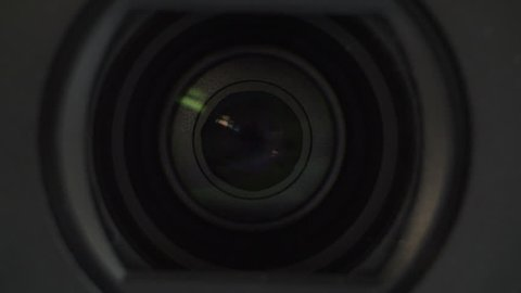 Camera Lens zooming in and out, CU