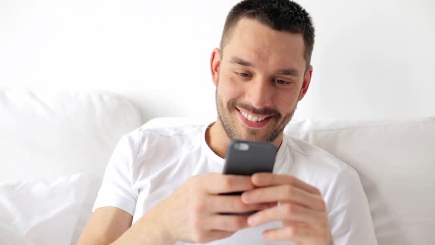 Guy enjoying the Instagram app on his phone