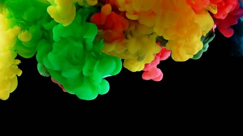 Colorful rainbow paint drops from above mixing in water. Ink swirling underwater. Cloud of ink isolated on black background with alpha. Colored abstract smoke explosion animation effect. Close up view