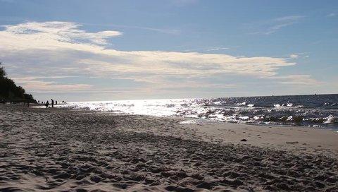 Baltic sea, static scene. Sand, blue sky, sea water and waves. Beach in Jastrzebia Gora, Poland