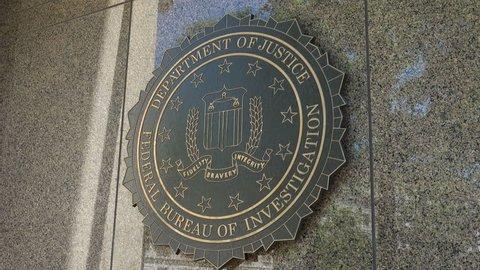 WASHINGTON, DC - JUNE 4, 2017: FBI seal - zoom out, Federal Bureau of Investigation headquarters building -  J. Edgar Hoover Building, Washington, DC. FBI operates under the U.S. Justice Department.