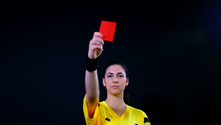 Woman football soccer referee shows penalty red card on black background, 4k