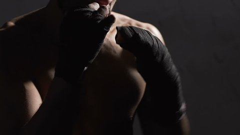 Male athlete shade boxing in the gym, Muay Thai boxer training before fight