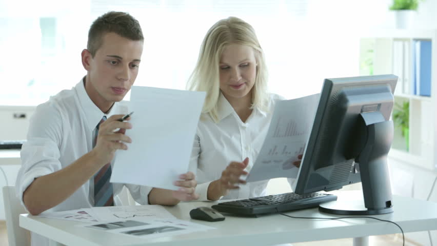 Young office workers being occupied with paperwork | Shutterstock HD Video #2755715