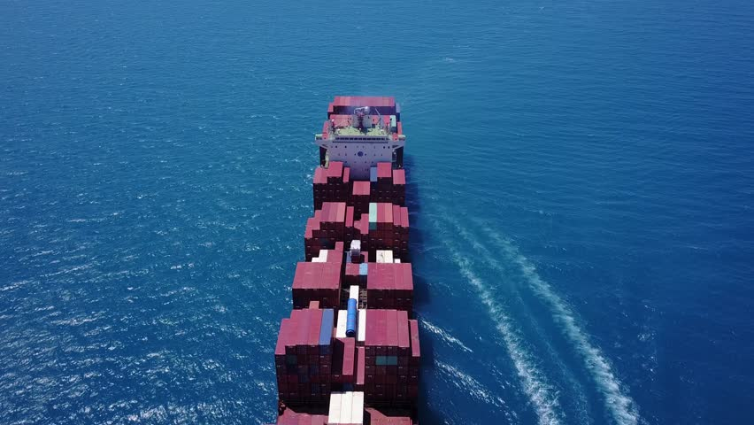 Large container ship in open sea loaded - aerial 4k view | Shutterstock HD Video #27560515