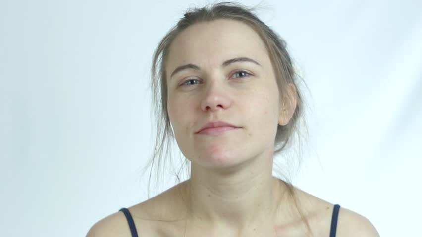 the Girl Without Makeup. She Has Severe Itching in the Ear.