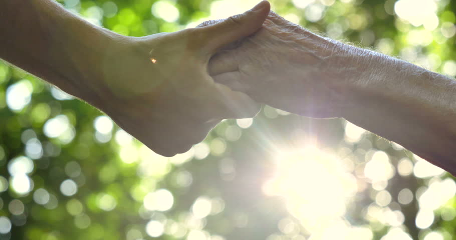 The hand of a young girl (woman) holds the hand of an elderly person, a sign of love, help, faith and support, help to relatives. Concept boarding house, sanatorium, nursing home, help for the elderly | Shutterstock Video #27586645