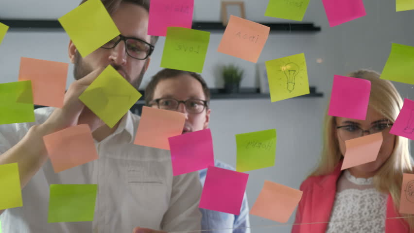 Creative business team brainstorming ideas working together sharing data late at night after hours in modern glass office 20s 4k | Shutterstock HD Video #27610171