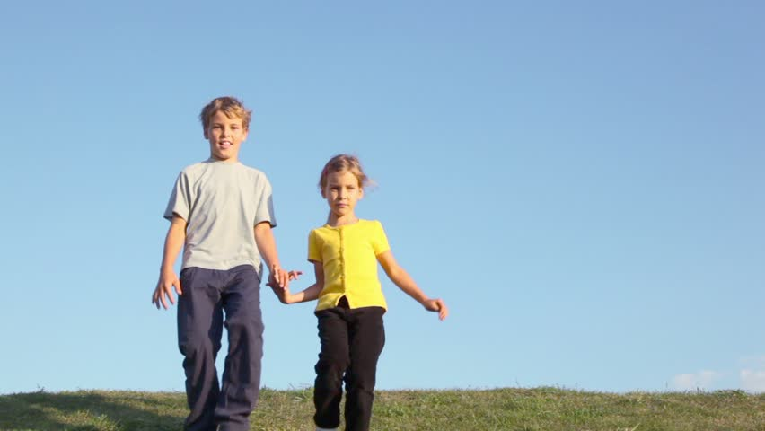 Two kids boy with little girl hold hands and approach from behind of two kids boy with little girl hold hands and approach from behind of grass hill at sunny summer day stock footage video 2761115 shutterstock ccuart Gallery