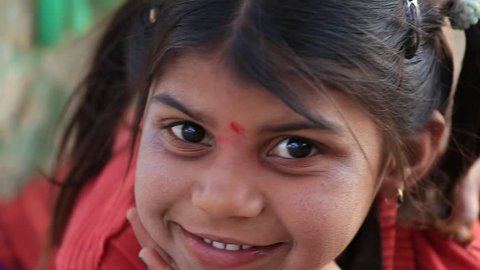 MANDU, INDIA - FEBRUARY 03, 2017 : An unidentified Indian children girl on the street . Poverty is a major issue in India