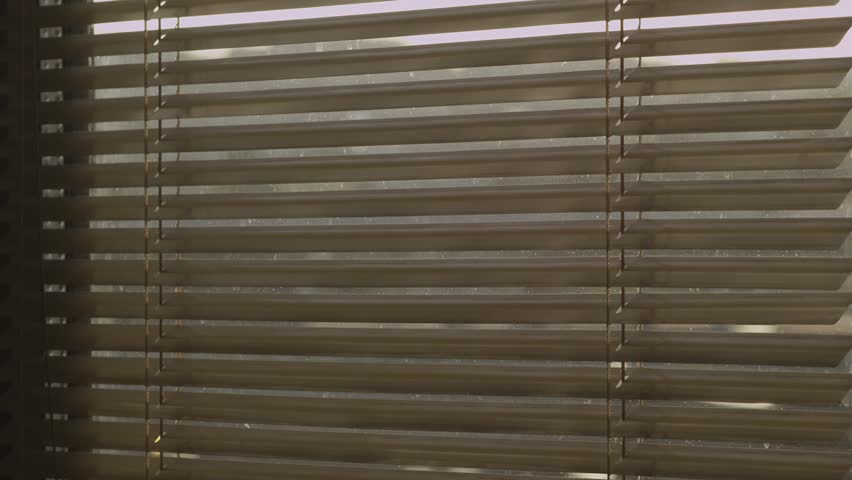 Diagonal medium shot of venetian blinds in action. Out of focus background.   | Shutterstock HD Video #2762915