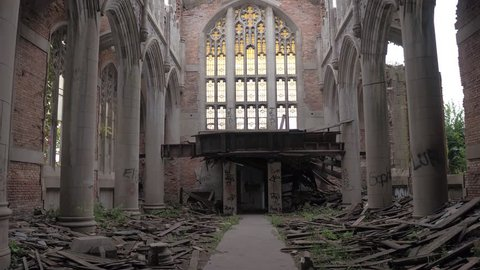 CLOSE UP: Exploring ruins of stunning crumbling sanctuary in abandoned City Methodist Church, USA. Beautiful old religious building with stunning architectural features, columns, adornments collapsing