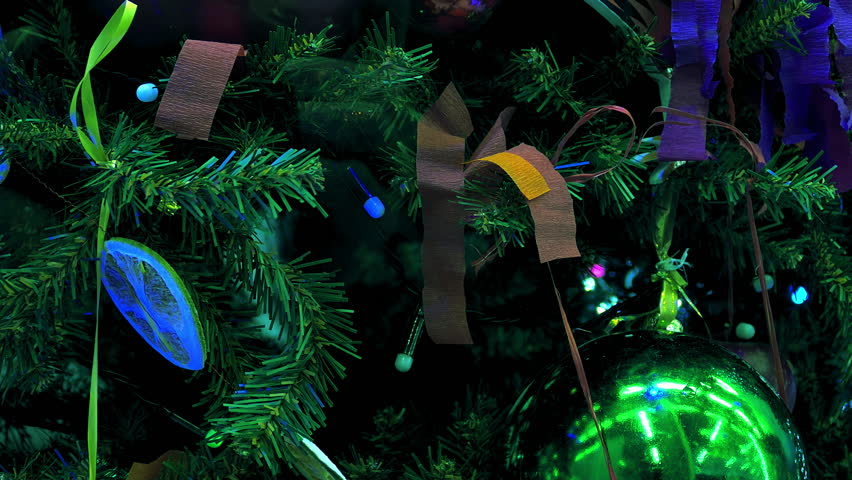 Christmas tree with decorative balls and paper tape flashing colorful lights.