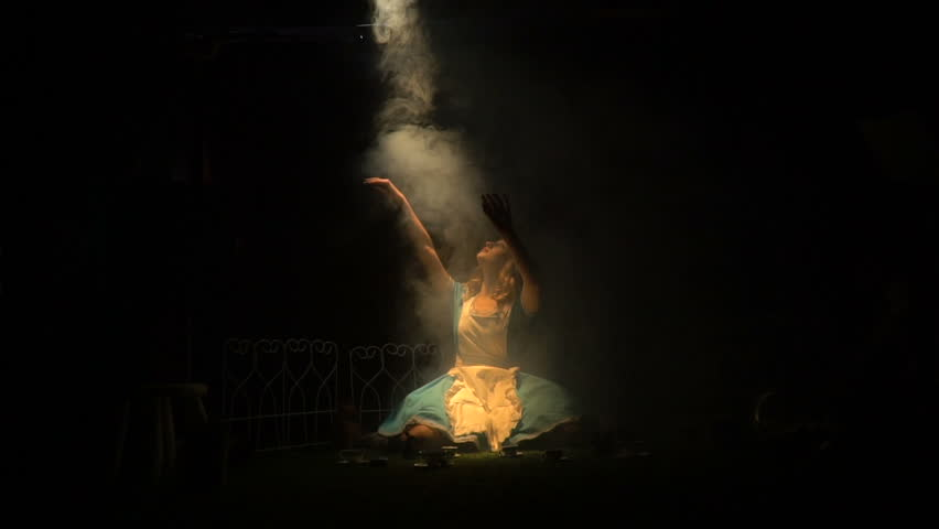 Alice sits in smoke and reaches for the light