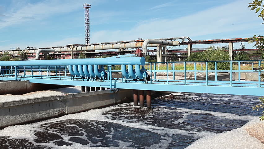 Blue pipelines with oxigen for sewage aeration on water treatment plant.