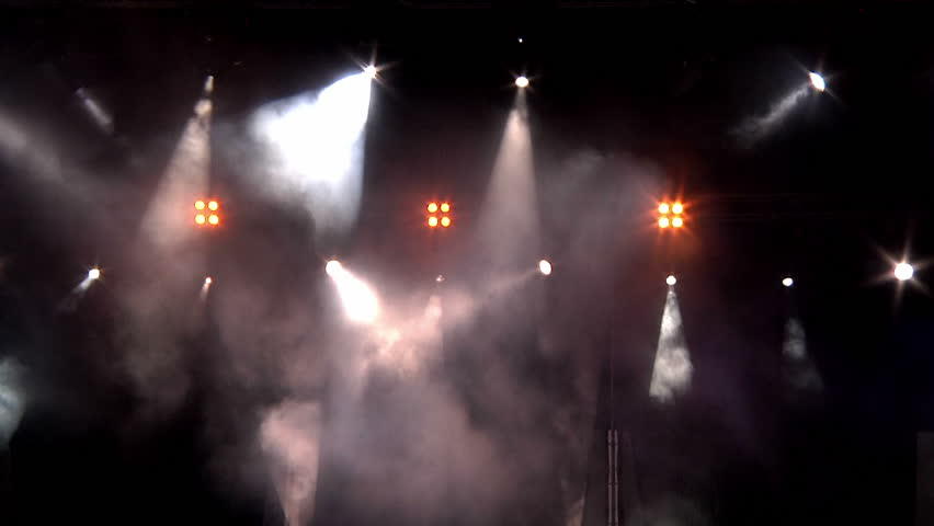 lighting in the smoke at a rock concert