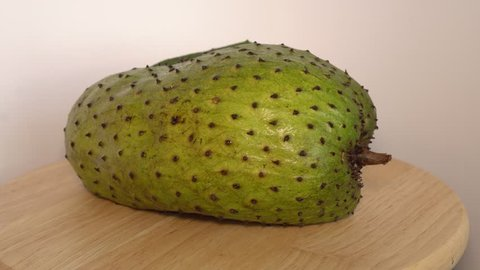 Soursop, Annona muricata L with slice rotate on wooden cutting board