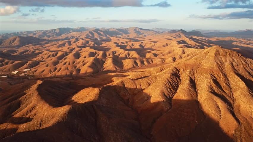 Flight over desert landscape, Fuerteventura island, Spain