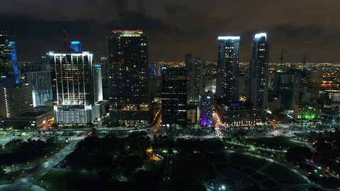 MIAMI, FL, USA - JUNE 11, 2017: Aerial flyby Downtown Miami at night drone 4k 24p prores