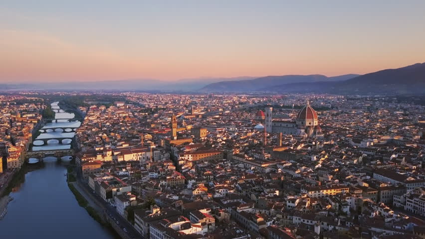 florence aerial shot at sunrise flying over city center cut two